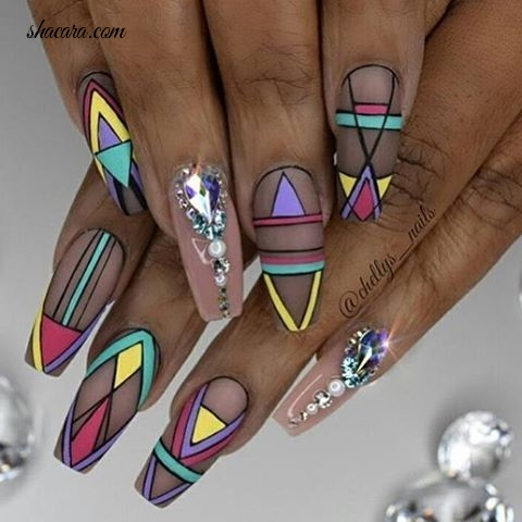 EMBRACE YOUR HERITAGE WITH THESE AFRICAN INSPIRED NAIL ART DESIGNS.